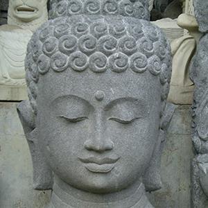 Tête de Bouddha sculpté en pierre de lave